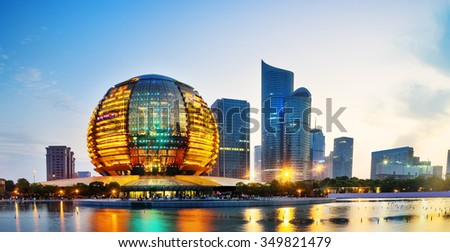 landscape of reflection of modern buildings at night.waterfront