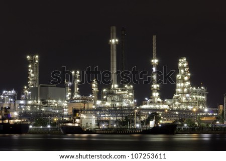 Landscape of river and oil refinery factory after sunset time in Chao praya river, Bangkok, Thailand. - stock photo