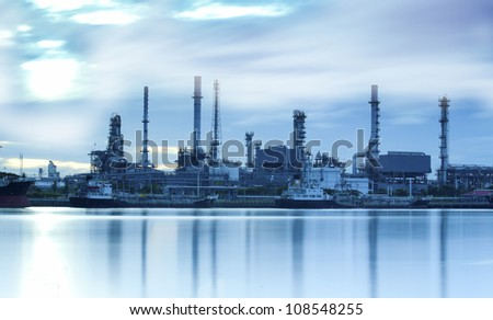Landscape of river and oil refinery factory between sun rise time in Chao praya river, Bangkok, Thailand. - stock photo