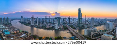 Landscape of river in Bangkok cityscape with sunset.