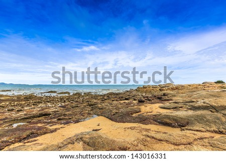 landscape of rock beach with white cloud and blue sky, pattaya, thailand