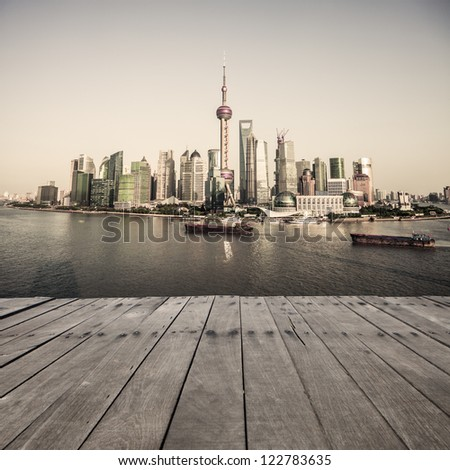 landscape of shanghai with wooden floor - stock photo