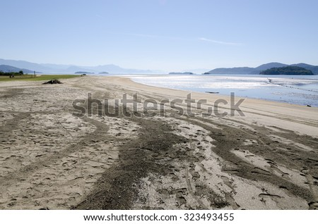 landscape of silt and sand with low tide in Paraty in Brazil