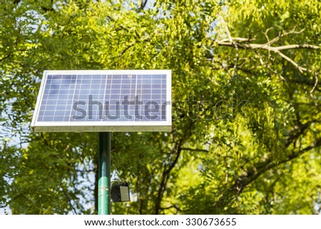Landscape of solar panels located in a park on a clear day