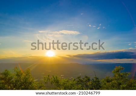 Landscape of sunrise over mountains - stock photo