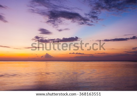 Landscape of sunset ocean with low shutter speed technique