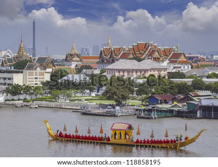 Landscape of Thai's king palace with goldent guard ship on the front.