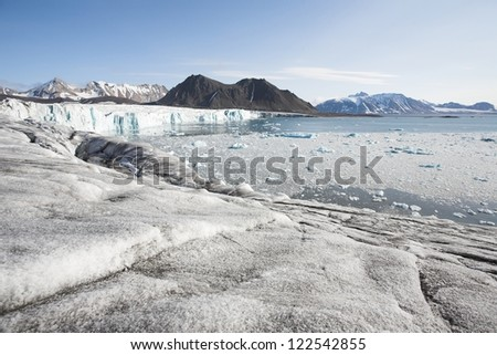 Landscape of the Arctic: ice, fjord, mountains - stock photo