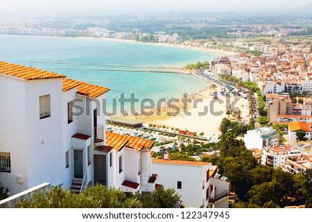 Landscape of the city and sea beach (Spain, Catalonia) - stock photo