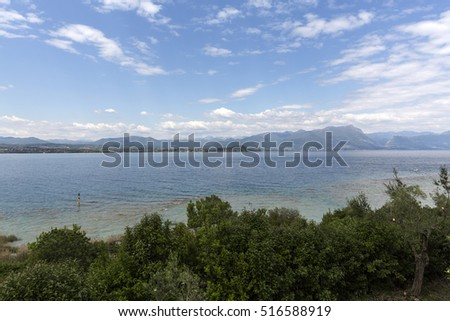 Landscape of the coast of Sirmione peninsula which divides the lower part of Lake Garda. It is a famous vacation place for a long time in northern Italy.
