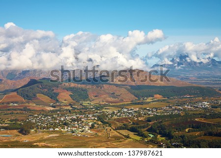 Landscape of the famous Franschhoek Valley wine region in the Western Cape of Southern Africa as seen from the top of the surrounding mountains