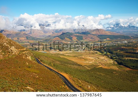 Landscape of the famous Franschhoek Valley wine region in the Western Cape of Southern Africa as seen from the top of the surrounding mountains - stock photo