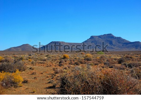 Landscape of the Karoo in South Africa showing the Hantam mountains viewed from the little town of Calvinia in the Northern Cape during a dry summer season. - stock photo