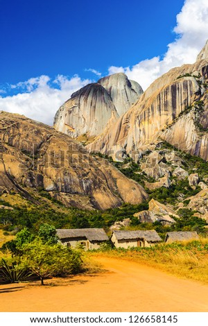 Landscape of the mountains and houses of Madagascar - stock photo