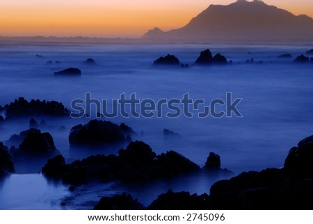 Landscape of the ocean at sunset in Gordon's Bay, South Africa - stock photo