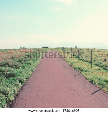 Landscape of the road to the hill with retro filter effect - stock photo