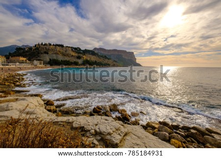 Landscape of the sea, the waves, the beautiful cloudy sky. Cassis, France, View on the old castle and the cliff Cap Canaille