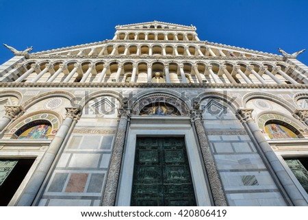 landscape of the square of Pisa Tuscany Italy with the leaning tower and the white marble cathedral - stock photo