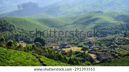 Landscape of the village o tea plantations in India, Kerala Munnar.  - stock photo