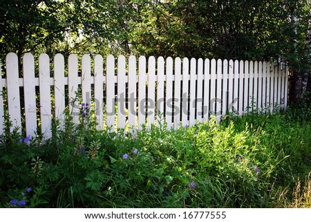 Landscape of the white fence in a farm