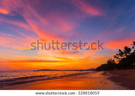 landscape of tropical beach and colorful sky at sunset in Krabi province, Thailand - stock photo