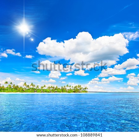 landscape of tropical island beach with palm trees and sunny blue sky. holidays background - stock photo