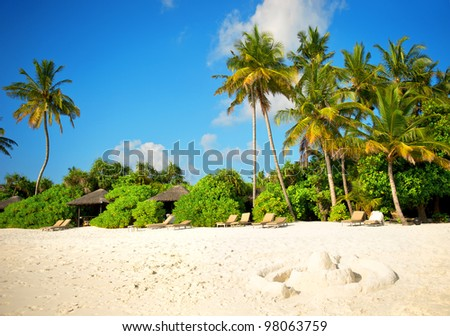 landscape of tropical island beach with perfect cloudy blue sky - stock photo