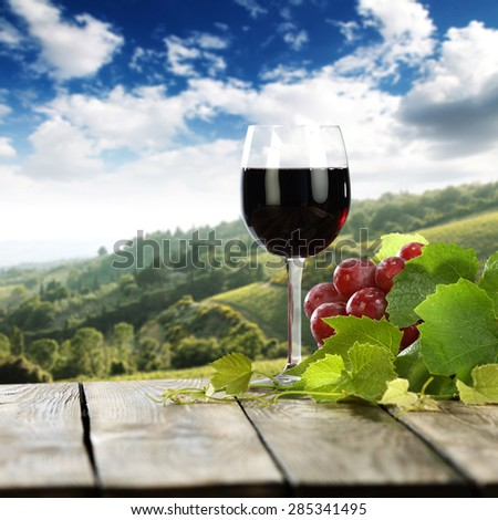 Landscape of Tuscany and table place fruits and leaves