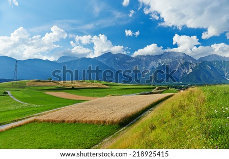 landscape of valley in Austrian Alpine mountains, agriculture crops field rural scene, picturesque view  - stock photo