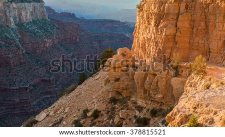 Landscape of walley and huge rock mountains wall painted orange by the warm sun in Colorado mountains, USA - stock photo