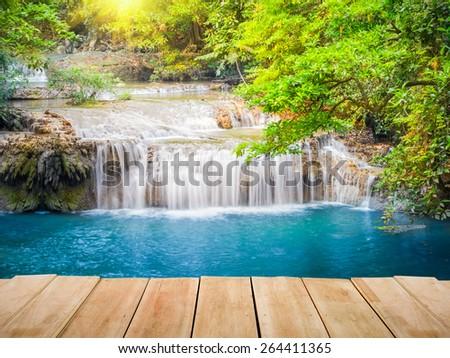 Landscape of waterfall with wood bridge. - stock photo