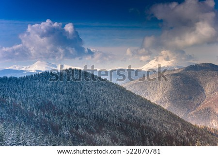 Landscape of winter mountains with a lot of snow at sunny day.