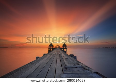 Landscape of Wooded bridge in the port and sunrise - stock photo