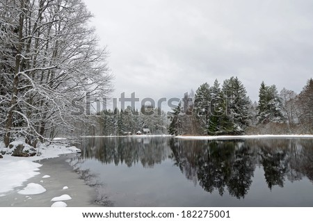 Landscape off trees and river after winter frost - stock photo