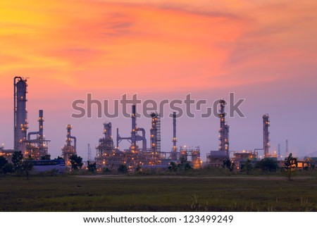 Landscape oil refinery with beautiful sky at sunset - stock photo