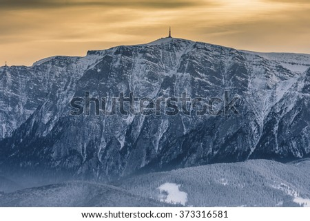 Landscape over Bucegi Mountains at sunset in winter season, with view from Postavaru peak.The Bucegi Mountains are located in central Romania, south of the city Brasov.  - stock photo