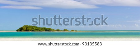 Landscape panorama of a Tropical island with mangrove trees, beautiful sky and clear ocean waters. Taken at Bahia Honda state park in the Florida Keys. Copyspace. - stock photo