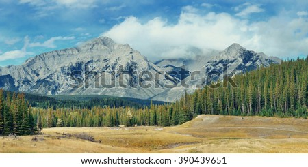 Landscape panorama of Banff National Park in Canada with snow capped mountain - stock photo