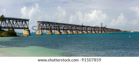 Landscape panorama of historic Florida landmark, Flagler railway bridge that used to connect Miami and Key West on a beautiful sunny summer day. Damaged by hurricane in 1935. - stock photo