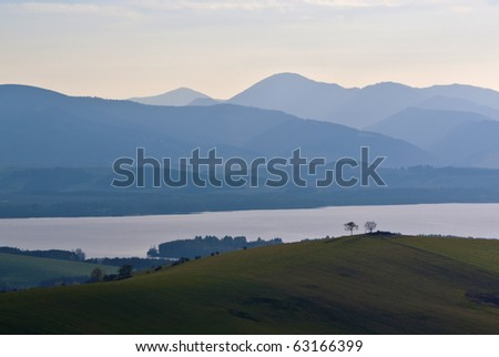 Landscape panorama with the mountains and lake