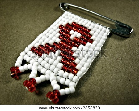 Landscape photo of a traditional african AIDS badge - stock photo