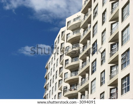 Landscape photo of apartments by the see - stock photo