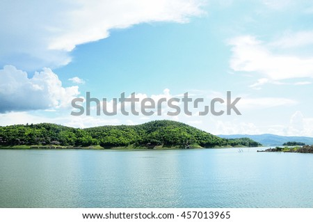 landscape photo of beautiful river with reflex blue sky and white cloud  - stock photo