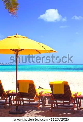 Landscape photo of Coast beach sleeping chair in Maldive beach front villa - stock photo