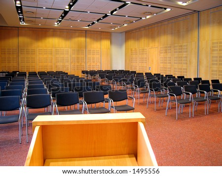 Landscape photo of conference room interior from lecturn. - stock photo