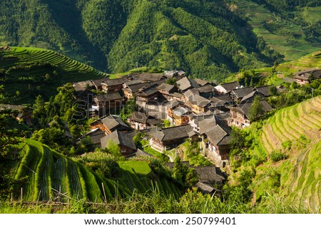 Landscape photo of rice terraces and village in china - stock photo