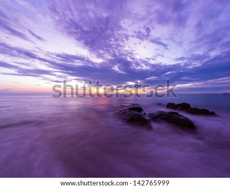 Landscape photo of rocks in the sea in sunset