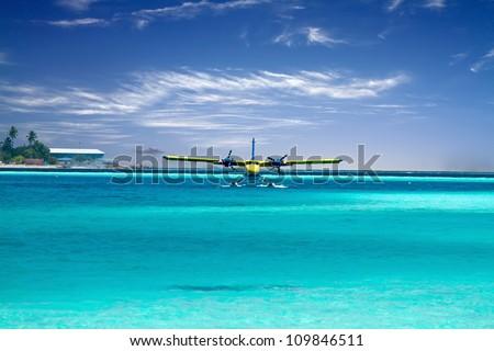 Landscape photo of Sea plane taking off in ocean - stock photo