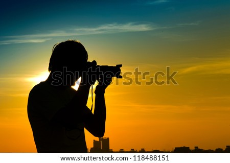 Landscape photographer in back light