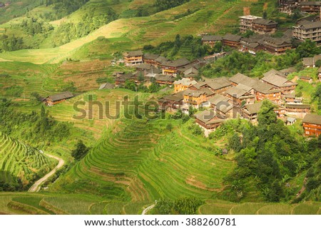 Landscape rice terraces and village in china - stock photo